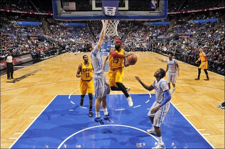 LeBron James driving to basket vs. Orlando Magic on December 26, 2014