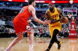 LeBron James driving against Pau Gasol