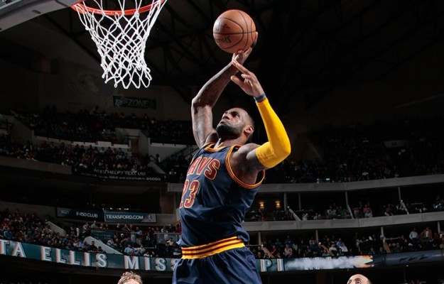 LeBron James dunking against Dallas Mavericks on March 10, 2015