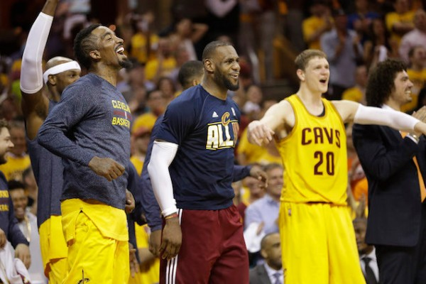 J.R. Smith, LeBron James and Timofey Mozgov