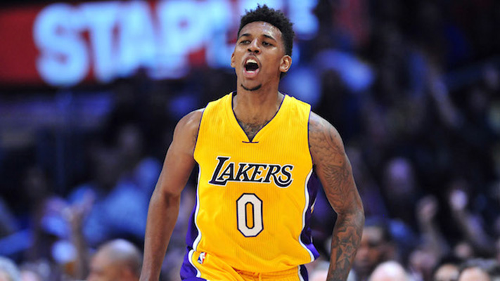 December 23, 2014; Los Angeles, CA, USA; Los Angeles Lakers forward Nick Young (0) reacts after scoring a three point basket against the Golden State Warriors during the first half at Staples Center. Mandatory Credit: Gary A. Vasquez-USA TODAY Sports