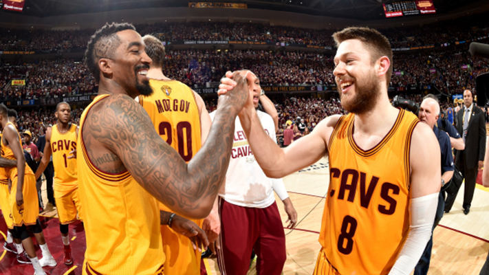 CLEVELAND, OH - JUNE 9: J.R. Smith #5 and Matthew Dellavedova #8 of the Cleveland Cavaliers shake hands after a victory over the Golden State Warriors in Game Three of the 2015 NBA Finals at The Quicken Loans Arena on June 9, 2015 in Cleveland, Ohio. NOTE TO USER: User expressly acknowledges and agrees that, by downloading and/or using this Photograph, user is consenting to the terms and conditions of the Getty Images License Agreement. Mandatory Copyright Notice: Copyright 2015 NBAE (Photo by Andrew D. Bernstein/NBAE via Getty Images)