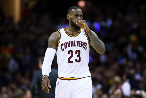 CLEVELAND, OH - JUNE 16:  LeBron James #23 of the Cleveland Cavaliers reacts in the first quarter against the Golden State Warriors during Game Six of the 2015 NBA Finals at Quicken Loans Arena on June 16, 2015 in Cleveland, Ohio. NOTE TO USER: User expressly acknowledges and agrees that, by downloading and or using this photograph, user is consenting to the terms and conditions of Getty Images License Agreement.  (Photo by Ezra Shaw/Getty Images)