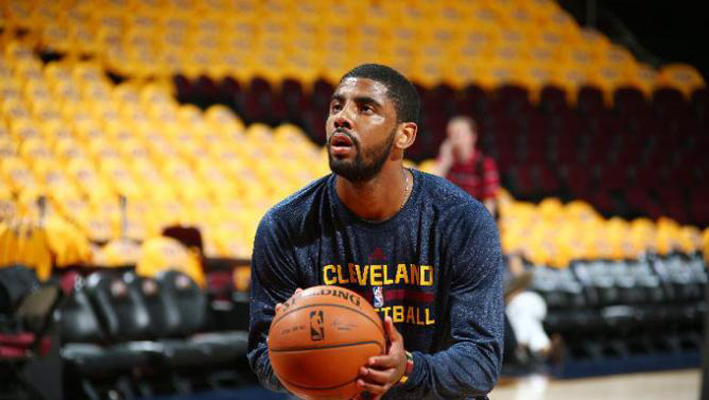 CLEVELAND, OH - MAY 24:  Kyrie Irving #2 of the Cleveland Cavaliers warms up before Game Three of the Eastern Conference Finals against the Atlanta Hawks during the 2015 NBA Playoffs on May 24, 2015 at Quicken Loans Arena in Cleveland, Ohio.  NOTE TO USER: User expressly acknowledges and agrees that, by downloading and or using this Photograph, user is consenting to the terms and conditions of the Getty Images License Agreement. Mandatory Copyright Notice: Copyright 2015 NBAE (Photo by Nathaniel S. Butler/NBAE via Getty Images)