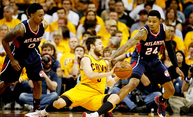 CLEVELAND, OH - MAY 24:  Jeff Teague #0 and Kent Bazemore #24 of the Atlanta Hawks defend against Matthew Dellavedova #8 of the Cleveland Cavaliers in the first quarter during Game Three of the Eastern Conference Finals of the 2015 NBA Playoffs at Quicken Loans Arena on May 24, 2015 in Cleveland, Ohio. NOTE TO USER: User expressly acknowledges and agrees that, by downloading and or using this Photograph, user is consenting to the terms and conditions of the Getty Images License Agreement.  (Photo by Gregory Shamus/Getty Images)