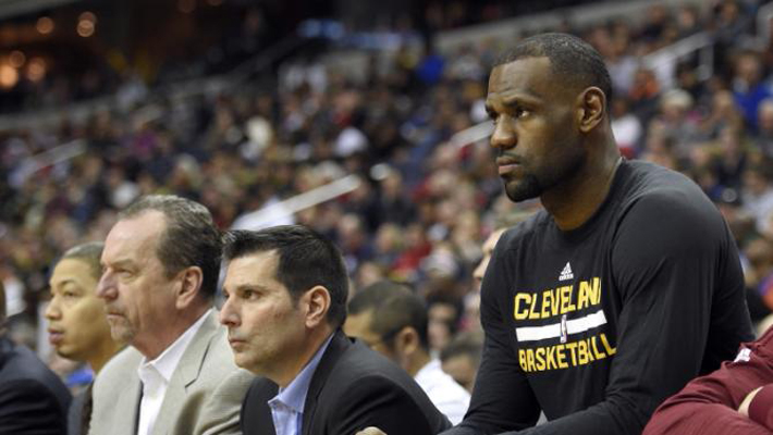 Cleveland Cavaliers forward LeBron James, right, looks on from the bench during the second half of an NBA basketball game against the Washington Wizards, Sunday, Feb. 28, 2016, in Washington. James did not play. The Wizards won 113-99. (AP Photo/Nick Wass)