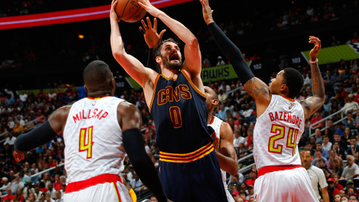 ATLANTA, GA - MAY 08:  Kevin Love #0 of the Cleveland Cavaliers drives the basket against Paul Millsap #4, Kent Bazemore #24 and Al Horford #15 of the Atlanta Hawks in Game Four of the Eastern Conference Semifinals during the 2016 NBA Playoffs at Philips Arena on May 8, 2016 in Atlanta, Georgia.  NOTE TO USER User expressly acknowledges and agrees that, by downloading and or using this photograph, user is consenting to the terms and conditions of the Getty Images License Agreement.  (Photo by Kevin C. Cox/Getty Images)