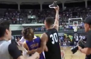 Video: Stephen Curry Throws Away Fan's LeBron Sneakers on Asia Tour