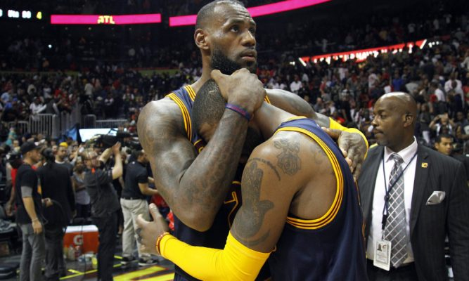LeBron James and Kyrie Irving Hugging