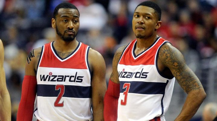 John Wall leaves arena with left arm in sling