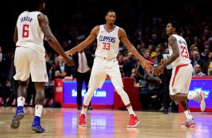 DeAndre Jordan, Wesley Johnson, and Lou Williams Clippers