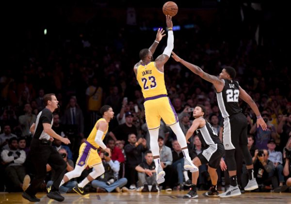 James delivers triple-double in first home win with Lakers