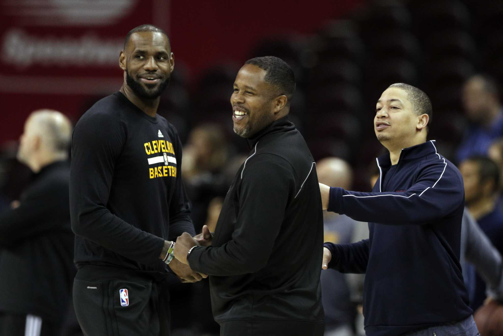 LeBron James, Damon Jones, and Tyronn Lue