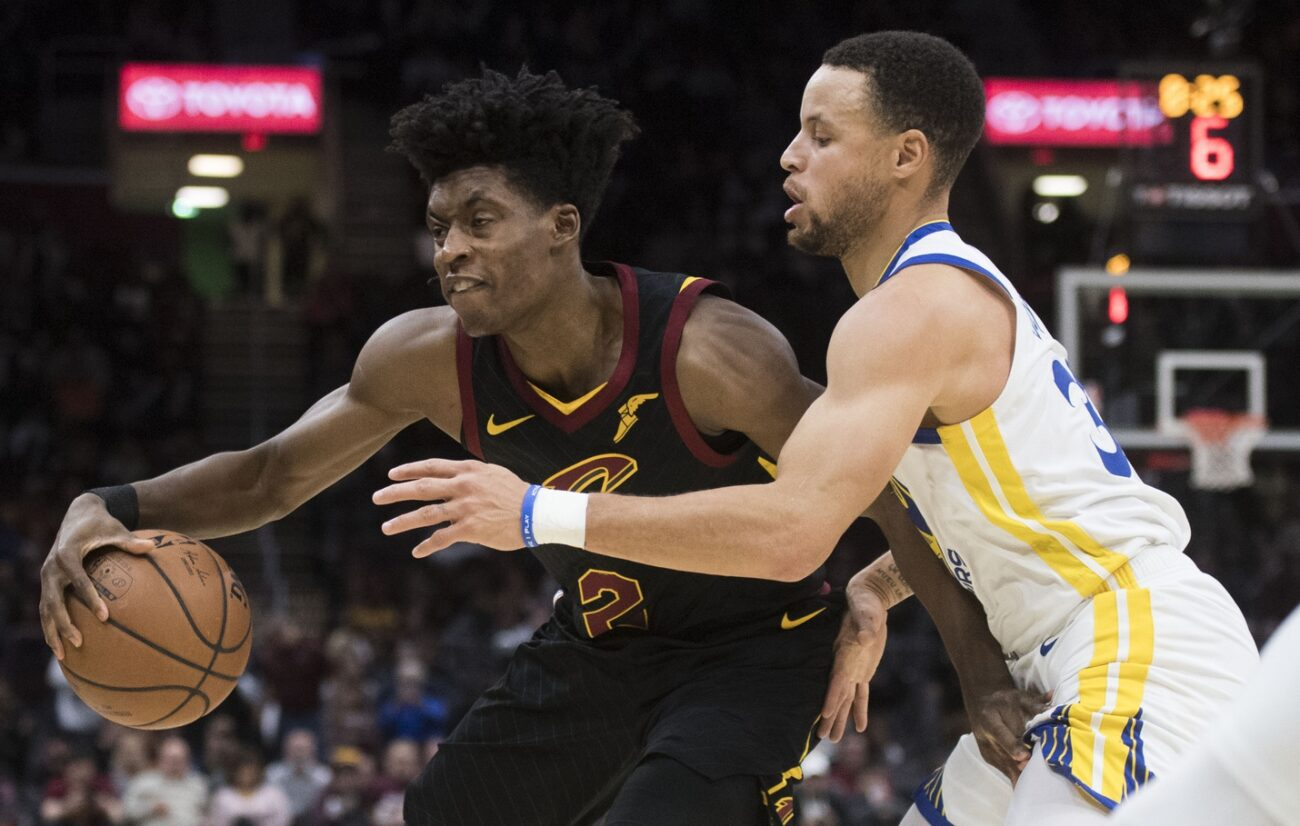 Collin Sexton and Stephen Curry
